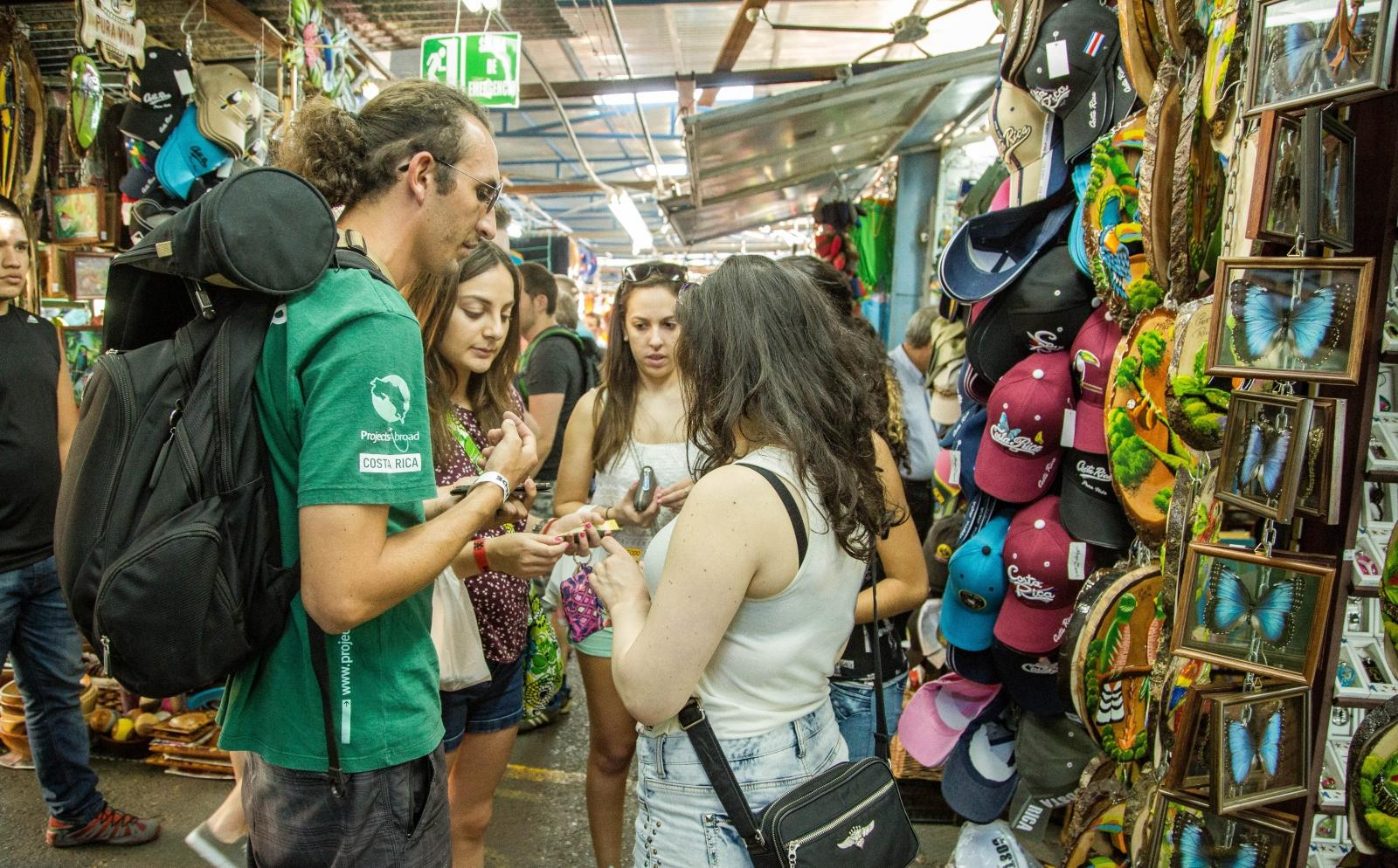 A Projects Abroad volunteer gets shown around a local market after his arrival in Costa Rica